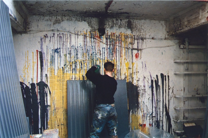 The artist working in his studio